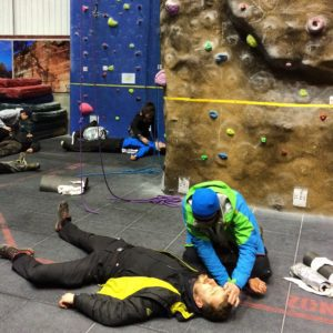 Learning to help a fallen climber at a climbing wall