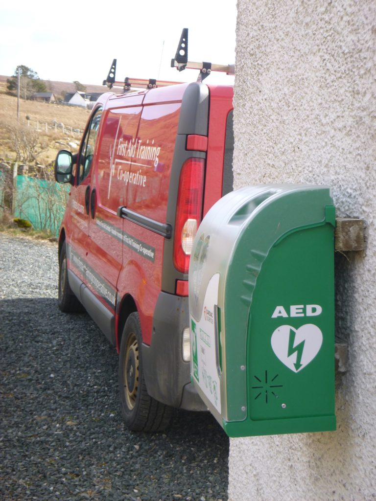 An AED on village hall