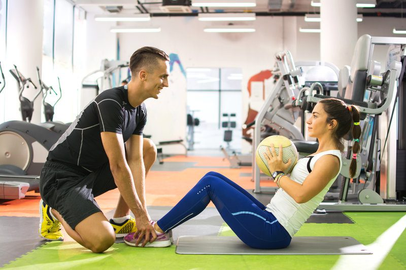 A professional exercise coach with his client