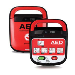 An AED defibrillator showing the face of the device - green button s=to start and orange button to deliver a shock