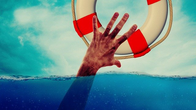 a hand trying to catch a lifebuoy
